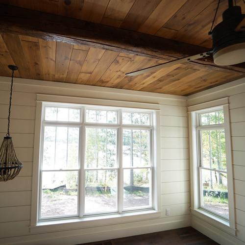 Lake-home-Master-bedroom-beams-1